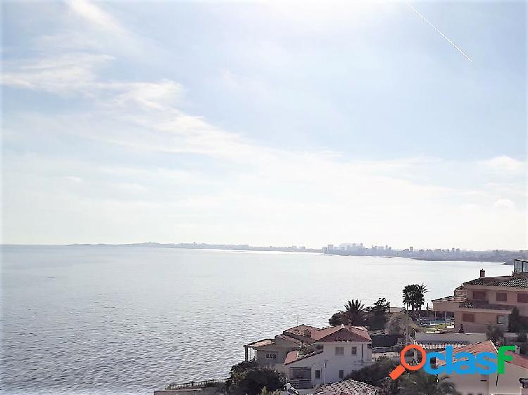 Magnífico chalet en el campello (coveta fumá) en primera línea y con impresionantes vistas al mar. casa de 318 m2, 950 m2 de parcela, 5 dormitorios, 3 baños, a/a, chimenea, suelos de mármor,
