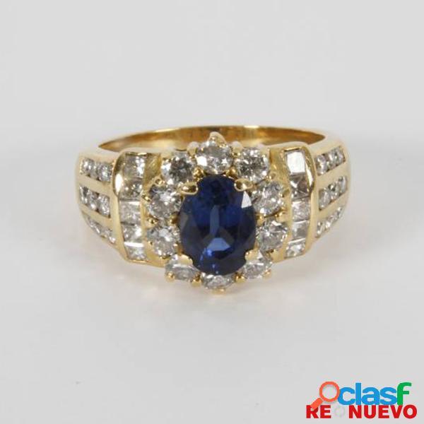 Anillo de oro con diamantes y un zafiro azul de segunda mano e298175j