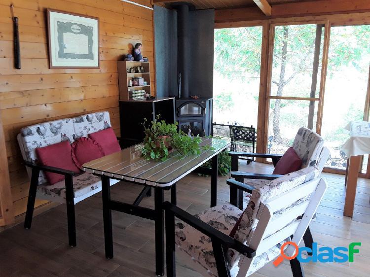 Casa de madera con terreno
