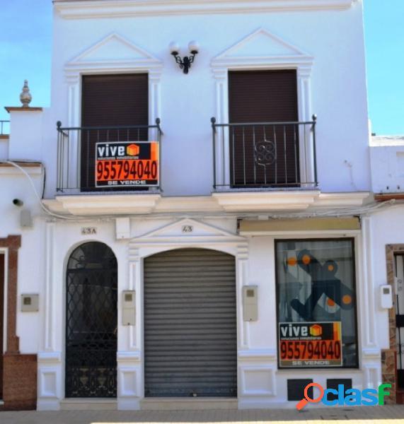 Casa mas local comercial