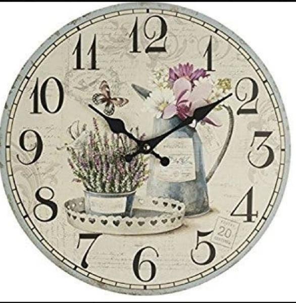Reloj pared y dos fundas cojines iguales