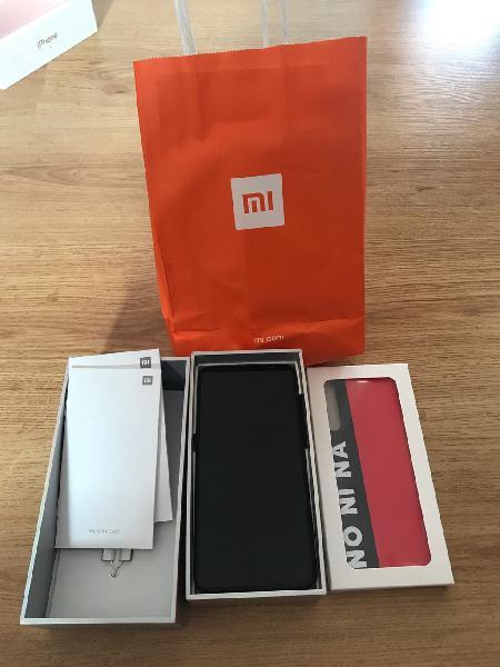 Xiaomi mi 9.con caja y fundas.nuevo