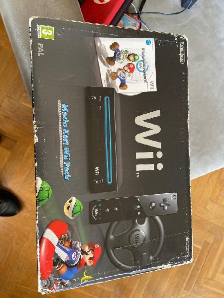 Wii con dos mandos ,volante y 4 juegos