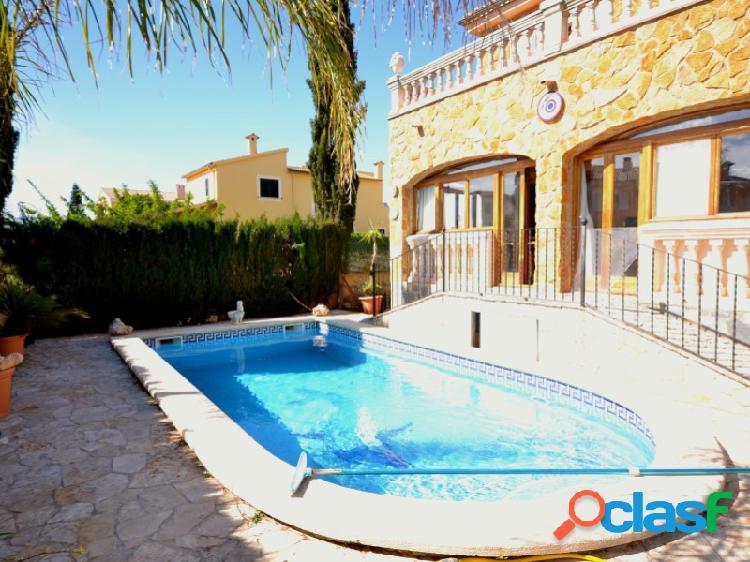 Casa unifamiliar bien cuidada con fachada de piedra natural y piscina en marratxi!