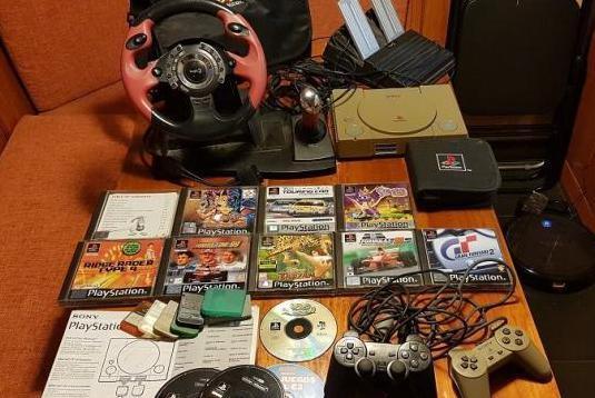 Play station con accesorios juegos