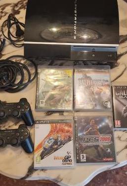 Playstation 3 con pack de dos juegos y mandos