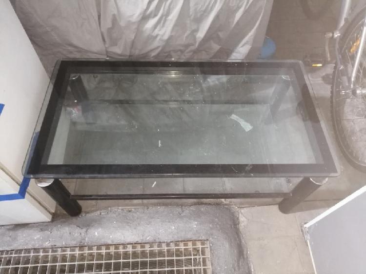 Mesa cristal abatible.