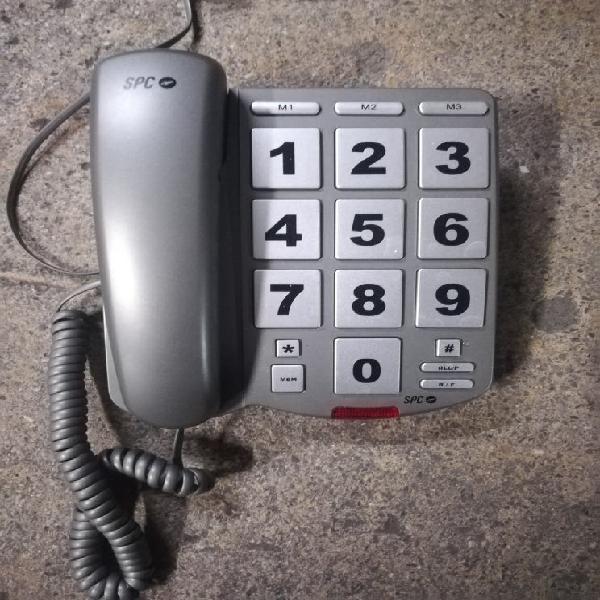 Teléfono fijo, teclas grandes.