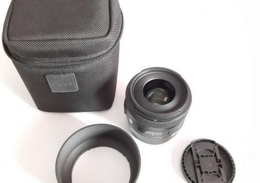 Sigma 30mm 1.4 art canon y calibrador de regalo