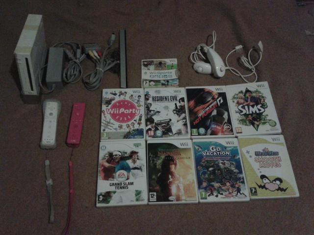 Wii + accesorios + juegos.