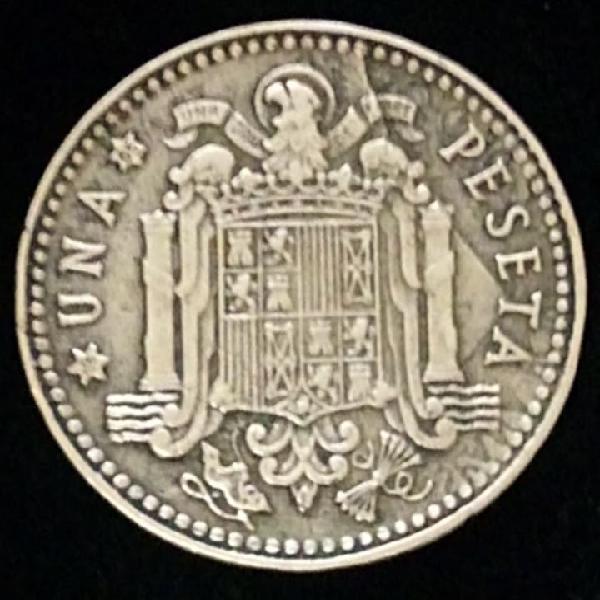 Una peseta de 1963 e.65 errores de troquel