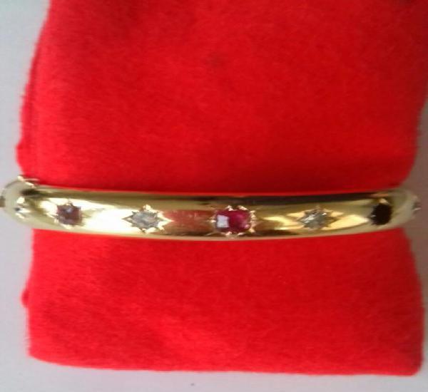 Pulsera de media caña oro 18 kt diamantes y rubi.