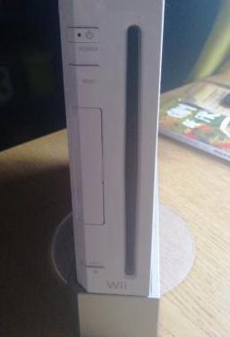 Wii con accesorios y tabla wifit