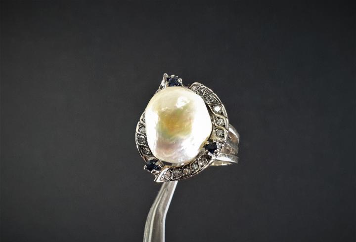 anillo en oro 19.2K con perla marcado con contraste