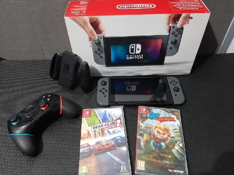 Consola nintendo switch mas juegos y mando.