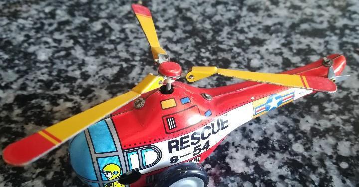 Juguete de chapa de cuerda estilo vintage helicóptero
