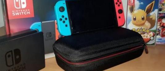 Nintendo switch con pokemon y mario kart 8