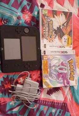 Nintendo2ds con dos juegos.