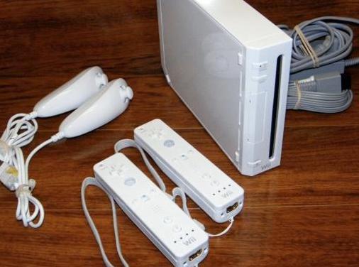 Wii con dos mandos y juegos