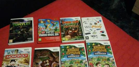 Consola wii con lote de juegos mandos ect
