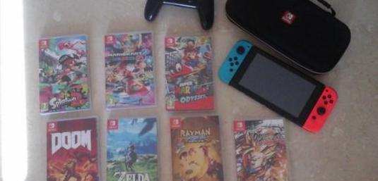 Nintendo switch con varios juegos un mando pro