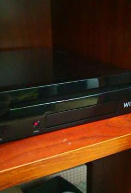 Wii u semi-nueva con juegos en garantia