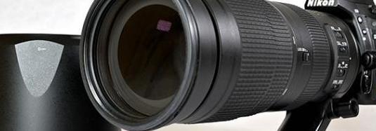 Zoom nikon 200-500mm f5.6 con bolso y camuflaje