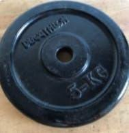 60 kg en discos de 15, 10 y 5