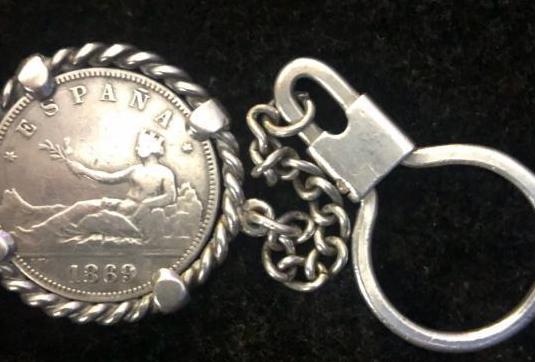 Articulo unico !! llavero de plata 2 pesetas 1869