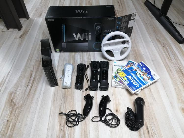 Wii negra con accesorios y juegos