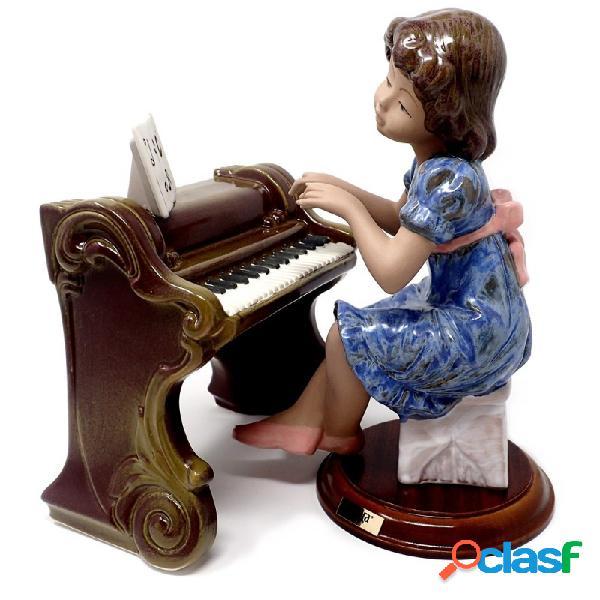 Figura niña porcelana piano notas musicales