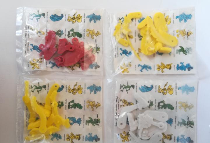 4 figuras articuladas goma pvc promoción detergente omo -