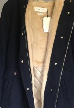 Abrigo nuevo con etiqueta formula joven
