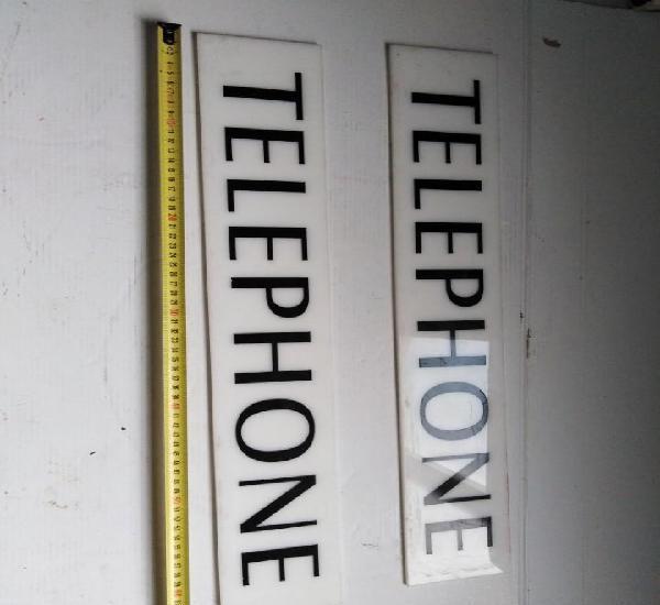 Dos carteles telefono telephone