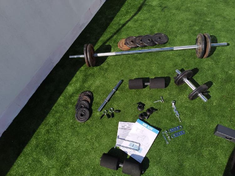 Máquina musculación + pesas + banco abdominales