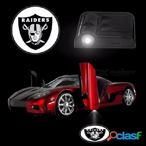 2 unids / set luces del coche sensor inalámbrico led bienvenido proyector logo fantasma lámpara de la sombra lámparas de la puerta del coche con pilas oakland raiders negro