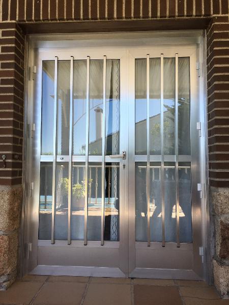 Puerta de aluminio doble hoja