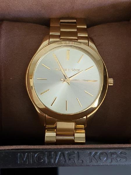 Reloj michael kors oro.
