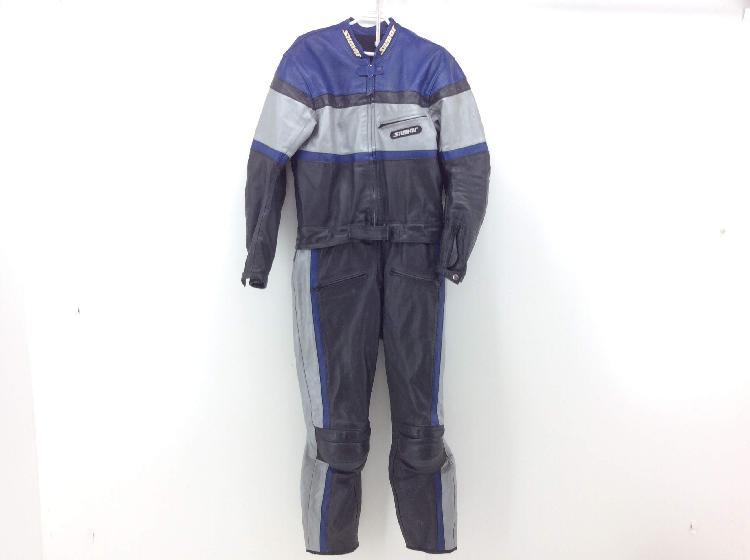 10 % traje mono otros azul, negro y gris
