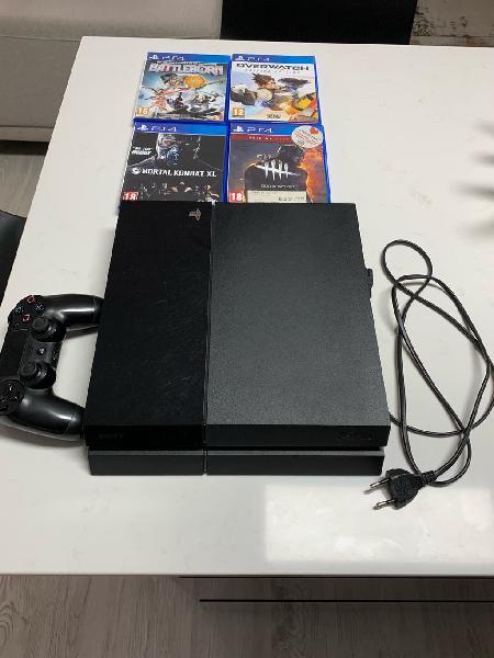 Playstation 4 con mando, cable y juegos