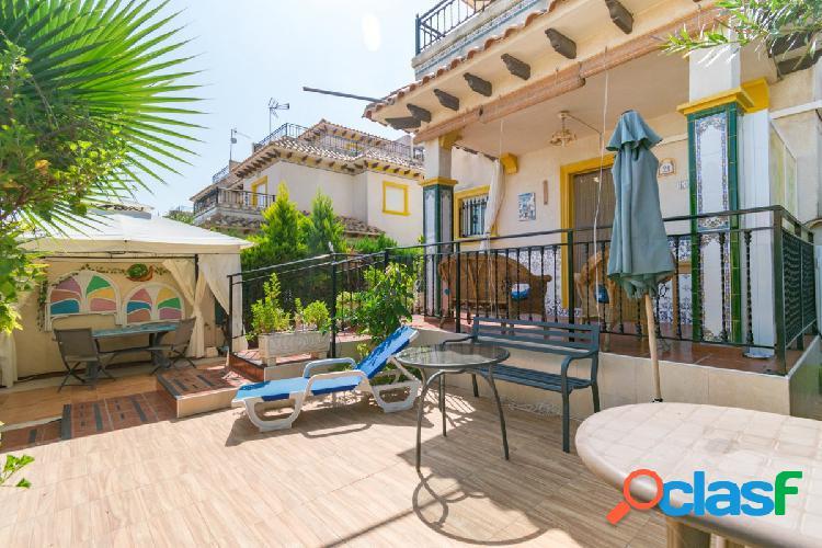Adosado en playa flamenca con amplio jardín privado