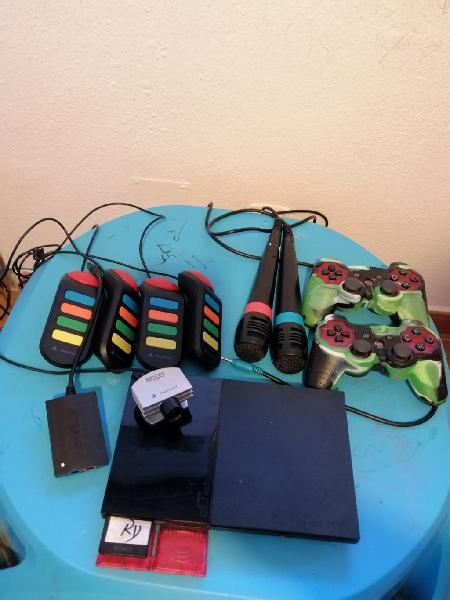 Consola ps2 con juegos y accesorios