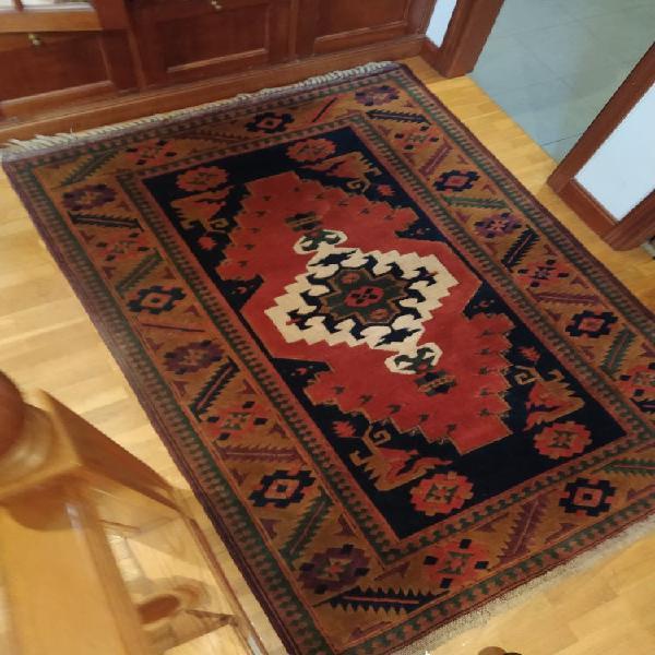 Alfombra persa de lana (costo 700)