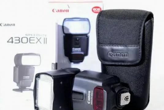 Flash canon 430 ex ii caja y funda