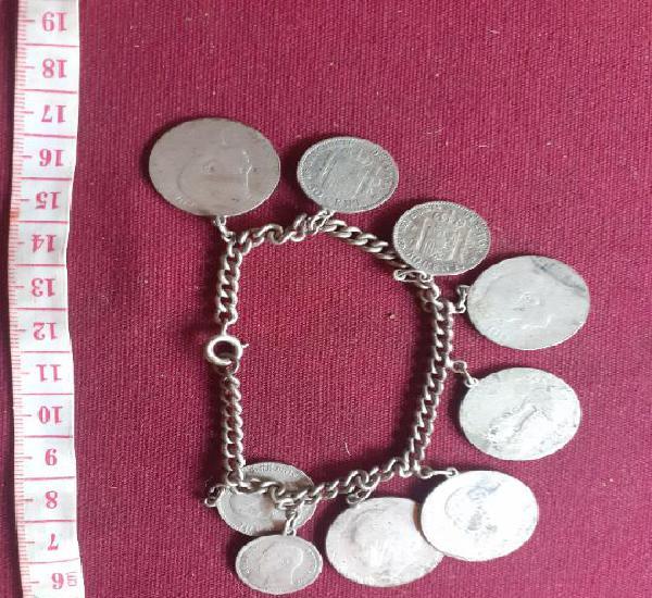 Pulsera antigua de plata. monedas de peseta y 50 céntimos