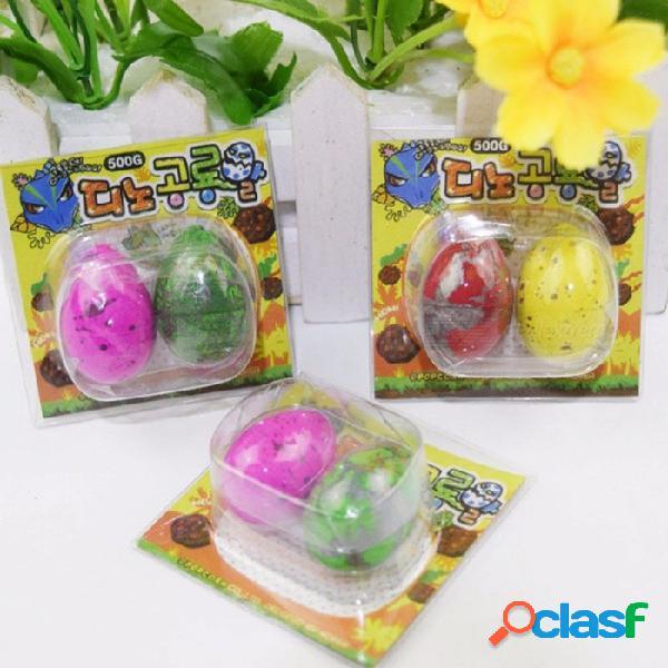 Linda magia trama de huevos de dinosaurio creciente novedad gag de juguete para niños niños, juguetes educativos regalos (2 piezas) color al azar