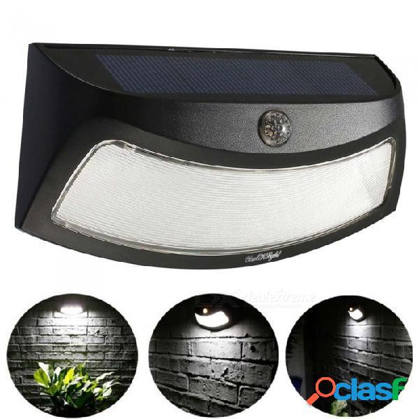 Lámpara de pared con sensor de movimiento alimentado por energía solar de youoklight, luz led de cara sonriente para iluminación exterior de patios y jardines