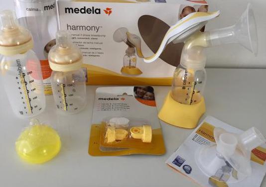 Medela biberones y extractor de leche manual