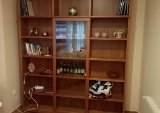 Librería con cristalera corredera
