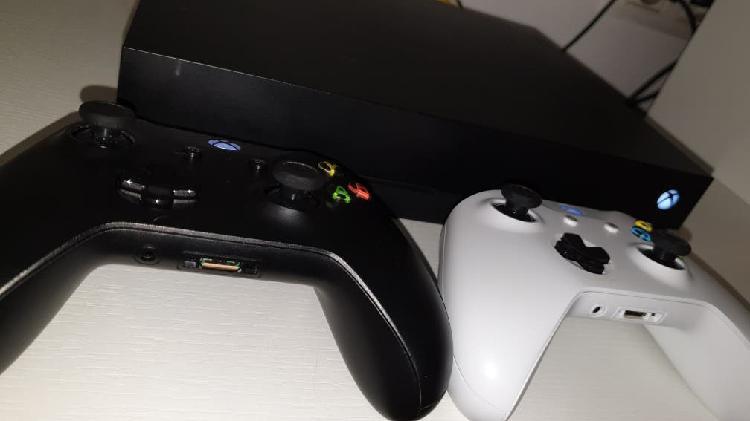 Xbox one x 4k + 2 mandos y 51 juegos